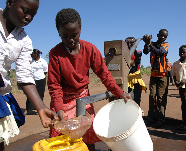 Children fill containers with safe water at a Mark II-type handpump, at the primary school in Ngoanine Village in Xai-Xai District in Gaza Province. The pump was built as part of a UNCEF-supported programme to provide water points in district schools with limited access to safe water and to improve sanitation and hygiene practices. The programme also supports the formation of village water and sanitation committees to manage the water points.  In 2007 in Mozambique, half of the nations 20.9 million inhabitants are children. Strong economic growth has helped reduce under-five and maternal mortality rates, and primary-school enrolment is growing. However, the country remains one of the worlds poorest. Access to essential health-care services is limited, 64 per cent of the population lacks safe water and just 46 per cent have adequate sanitation. Malnutrition is also widespread; preventable diseases cause many child deaths; and the HIV/AIDS prevalence rate (at 16.1 per cent for the 15-49 age group) continues to rise. More than half a million children have been orphaned by AIDS and an estimated 140,000 children under 15 are HIV-positive. Working with the Government and partners, UNICEF supports: immunization; malaria-prevention efforts; antiretroviral (ARV) treatment for HIV-positive pregnant women and children; services to prevent mother-to-child HIV transmission; care and protection initiatives for orphans and other vulnerable children; and a range of other health, education and water and sanitation initiatives.